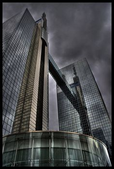 Belgacom-building, Belgium. The towers are both 102 metres (335 ft) tall to the roof, and Tower 1 has a spire reaching 134 metres (440 ft) high with a Belgian flag mounted on top. The two towers are linked by a 30 m long glass skyway between the 25th and 26th floors of each building.[Wikipedia]