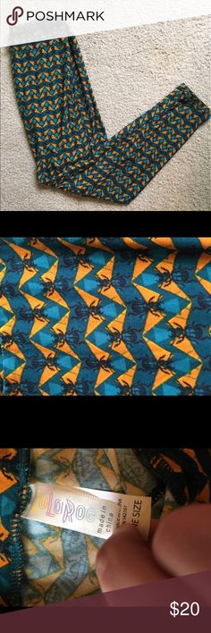 Lularoe Scarab Beetle Printed Leggings One size fits all leggings by Lularoe. Never worn, no flaws. Bright Beetle print. Super cute and soft!  I ship daily - excluding Sundays and holidays - and I store items in a smoke free, pet free environment. Open to offers; bundles discounted! LuLaRoe Pants Leggings