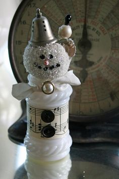 A snow man made from an old salt and pepper shaker...    http://mamiejanes.blogspot.com/2011_07_01_archive.html