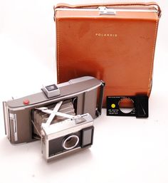 $25 etsy 1960's Polaroid Camera w/leather case.