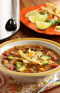 A slow cooker chicken tortilla soup recipe with chicken, Southwest mixed vegetables, zesty tomatoes, spices and fresh lime juice
