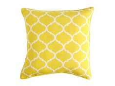 """It's made from polyester, so this one can go indoors or out. Cabana geometric 17"""" x 17"""" pillow in yellow, $20, pier1.com"""
