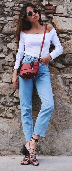 trendy outfit white off shoulder top bag boyfriend jeans heels