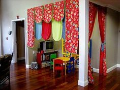 How to make your living room more kid-friendly (Super cute!  Wish i had a place in the living room to do this!)