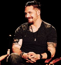 When you are talking to someone but you remember something funny but try to stay cool. ...Tom Hardy