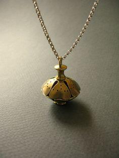 Dorothy Cheng's Golden Rose - brass pomander pendant