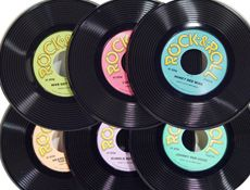 9 inch Plastic Records - Website Description:   Music, 1950's, or Rock and Roll Party Decorations. Plastic Record. Label printed 2 sides. 3 per pack.