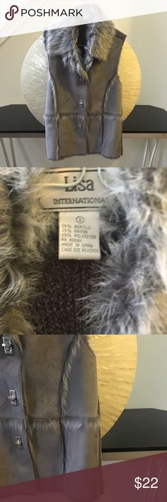 Gray fur lined suede vest In excellent condition with no flaws! Gorgeous gray suede sweater vest with faux fur trim. The front is suede and the back is sweater material. Thanks for looking and make an offer.💕 Outerwear by Lisa Jackets & Coats Vests