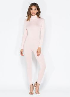 The Augujstina jumper is stretchy and features a seamless mockneck, long sleeves and tight legs. #jumpsuit #catsuit #black #blush #sexy #seamless #mockneck