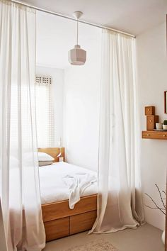 Remember for possible future studio apartments! Creating a room with tension rods and gorgeous curtains.