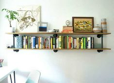Lovely pipe and plywood shelves. the solution for my awkwardly long guest bedroom wall? I've been wanting shelving anyway and I could do a few different sections at different heights! Kids Room Bookshelves, Small Bookshelf, Bookshelf Design, Bookcases, Diy Home Decor Bedroom, Teen Room Decor, Bedroom Wall, Bedroom Ideas, Wood Shelving Units