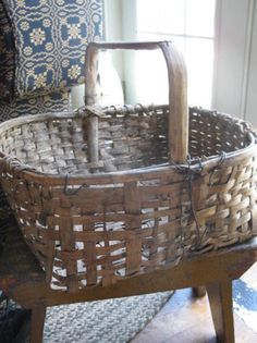 Love this old basket. It has been repaired with wire.wonder how many different people have carried it. Old Baskets, Vintage Baskets, Wire Baskets, Old Wicker, Bountiful Baskets, Vintage Stool, Primitive Furniture, Basket Weaving, Rustic