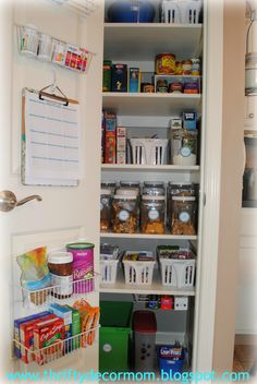 love the idea of baskets on the inside of door AND the little one hanging below shelf for the suran wrap and what not!