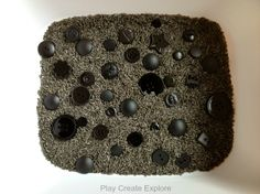 Black Buttons and Licorice Scented Rice Sensory Bin