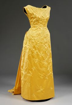 Evening dress    Cristóbal Balenciaga  1955  Satin embroidered with silk thread and gold pailletes, lined with silk and chiffon  Museum no. T.758-1972