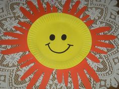 Hello sunshine! A paper plate for the sun's face & handprints' cut-outs for the rays!