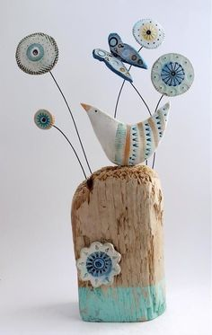 Swaths of flower heads.. Earthenware driftwood and vintage tape measure. 26cm x 15cm x 8cm. Can be seen at Saltbox Gallery. Sold.