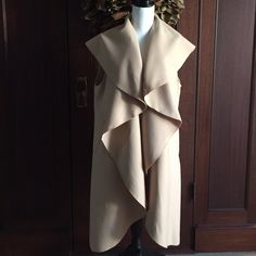"Super sought after sleeveless waterfall coat/vest I love this coat! Inspired by one of my favorite bloggers, I had the chance to buy a few extra for anyone else who might be looking for it!  Size L. 40.5"" Long. Could be worn open, belted, with a great body con black dress or leggings! Jackets & Coats Vests"