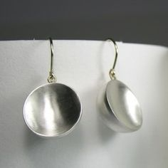 Drum earrings in sterling silver by Nazan Pak
