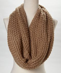 """Stay toasty and trendy in this hip infinity scarf spotlighting a thick, cozy knit. Perfectly posh, it spices up a limitless number of looks.12"""" W x 38"""" circumference100% acrylicHand wash; dry flatImported"""