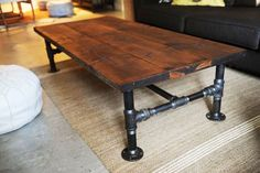 DIY Decorating Ideas: Industrial looking wood coffee tables can be quite expensive. To get the style and save money, make your own. This table was made with cedar planks and plumbing supplies. Another fun and easy project. Industrial Coffee Table Tutorial