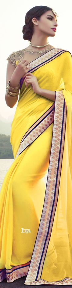 Laya couture. Yellow and blue georgette saree with sheer blouse. Indian fashion.