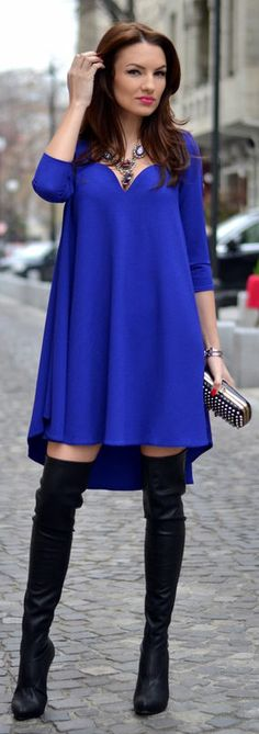 This royal blue dress looks so sexy with those hot boots.