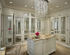 gorgeous cream dressing room with dripping chandelier, ghost chair & arched, mirrored doors ♔