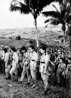 Japanese army woman combatants surrender after the Battle of Okinawa, 1945.