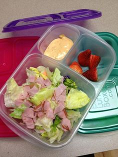 """How can you not have a good day with a bright colored lunch box and a yummy meal? Today we are having salad and strawberries :)"" via The Family Lunchbox"