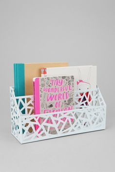 This is a fun idea to integrate the cutout trend into your work or desk space! A #geometric #cutout letter storage bin.