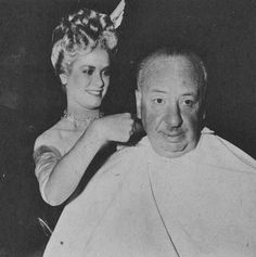 Grace giving Alfred Hitchcock a hair cut in between scenes lol