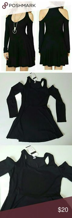 """Sale! Black Cold Shoulder Dress Limited Time Sale! This lovely black dress has the shoulders cut out like the cold shoulder look with tank top style shoulder straps and long sleeves and the waist tucked in with an A line skirt like a skater dress. This dress is a size small and made of stretchy polyester material. The measurements are 30"""" chest, 25"""" waist and 32"""" hip and it is 29"""" long. Brand new and unused! Aother cold shoulder shirts listed in my closet! Perfect with your favorite…"""