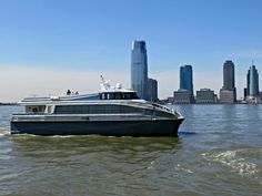 Ferry on the Hudson River, viewed from Battery Park City in Lower Manhattan, New York City. April 3, 2014.