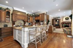 More medium tone cabinet stain (& wood floor) w/ white.  (& tile/countertop) to tie them together. **** kitchen islands or peninsula connecting two rooms - Google Search