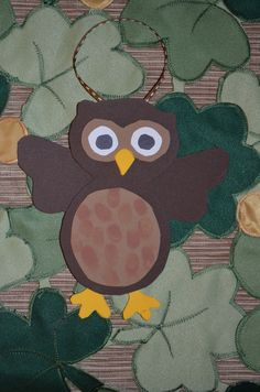 Foam owl with thumbprint feathers.