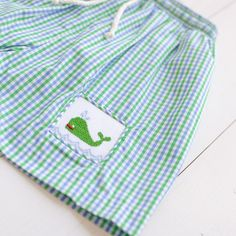 Our classic style Boys Nantucket Whale Swim Shorts in blue and green gingham features custom whale smocking. Team Gifts, Whale Watching, Nantucket, Swim Shorts, Smocking, Gingham, Classic Style, Boy Or Girl, Elastic Waist