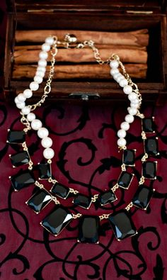 Shabby Apple Augustine Necklace. Black and pearl layered necklace.  Inner layer 17 inches.  Outer layer 20 inches long. Imported.