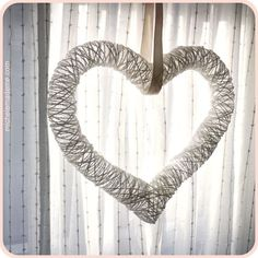 Great DIY~  <3 HEART <3 Made from a Balloon (the kind that can be animals) and yarn or twine. You can hang it as shown, or leave a little more space between and add crafts for a wreath. It you make it with twine support it to make a topiary. :)