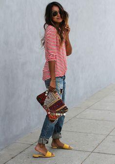way to wear boyfriend jeans: striped tee, bright sandals, tribal printed clutch