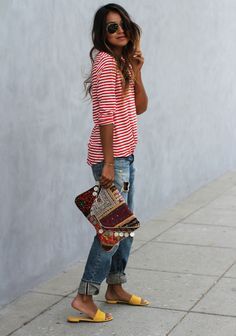 way to wear boyfriend jeans: striped tee, bright sandals, tribal printed clutch