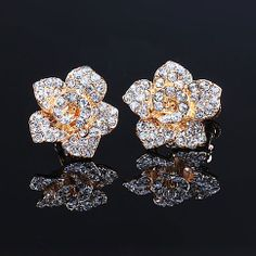 "Golden Flowers Rhinestones Stud Earring Ear Clip for Elegant Ladies Style: Retro  Material: Alloy / Rhinestone   Color: As picture   Size: Diameter:2CM(0.79"")  You needn't get your ears pierced,you can also wear this stud earrings.The gorgeous piece features pretty golden flower shape,stud with shiny rhinestones.Put your hair down and show off your little..."