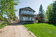 Homenova Slideshow- 4107 Lakeshore Dr, Sylvan Lake, Alberta