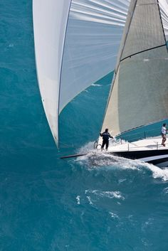 The bowman on Numbers, an IRC66, yells back to the afterguard while racing downwind under spinnaker during the 2008 Miami Grand Prix Regatta.
