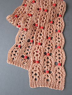 Bead Skinny Skarf is a play on words, reflecting on the fashion of cinching in a waist to look skinny. Bead Skinny gives the illusion of cinching the curvy lines of the faux eyelet cable with a pretty bead. Beading Patterns Free, Weaving Patterns, Knitting Patterns Free, Free Knitting, Crochet Patterns, Crochet Scarves, Crochet Yarn, Ravelry, Knitting Supplies