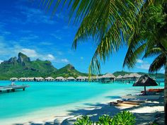 Bora Bora is an island in the Leeward group of the Society Islands of French Polynesia, an overseas collectivity of France in the Pacific Ocean. The island, located about 230 kilometres (140 mi) northwest of Papeete, is surrounded by a lagoon and a barrier reef.  (02)