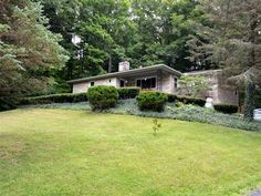 Beautiful stone home on a wooded lot located in the privacy of Forest Hills but…