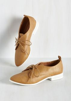 Midtown Mingle Flat. When skipping through the city in these caramel derbies, you never know who youll meet - but intros from those who love your vegan-friendly kicks are a guarantee! #tan #modcloth