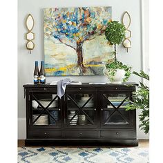 Belgard Cabinet- I think this would do the job holding serving pieces and barware in great room.