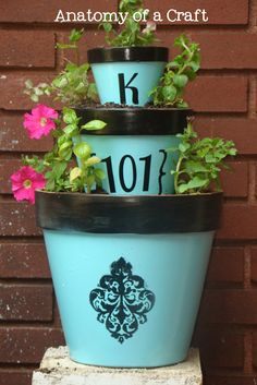 Great on small front porch maybe in or on an old table or chair DIY::Painted Planters. Maybe house # with street name.